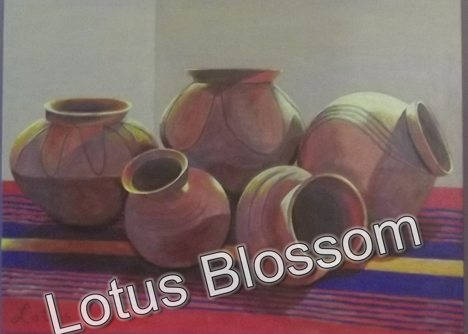 Indian pottery on blanket by Lotus